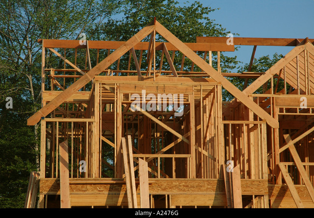 A house under construction in the framing stage stock for Construction stages of building a house