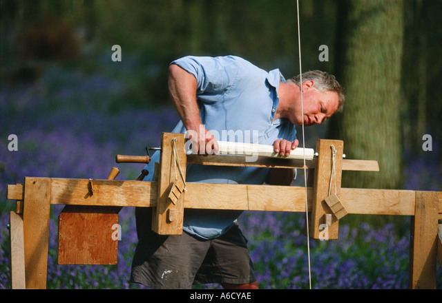 Green Wood Furniture Maker Using Pole Lathe In Bluebells And Hazel Stock Photo Royalty Free