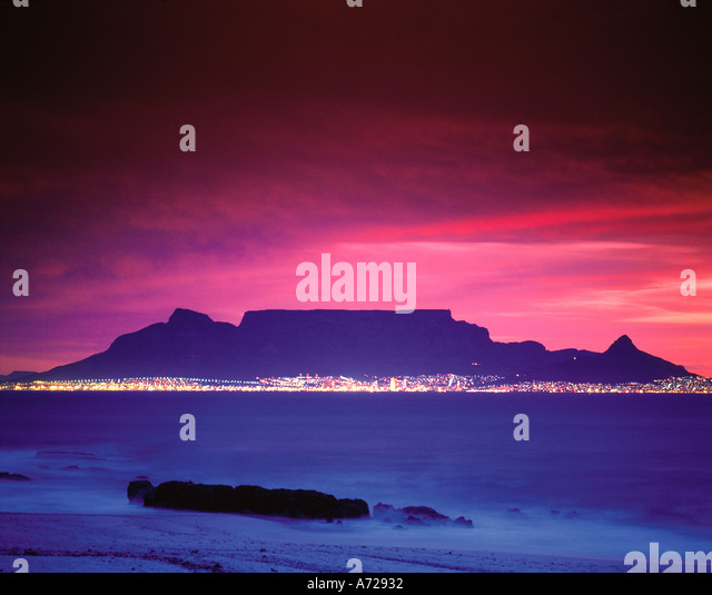 Cape Town And Table Mountain At Night As Viewed Across Table Bay Stock Photo