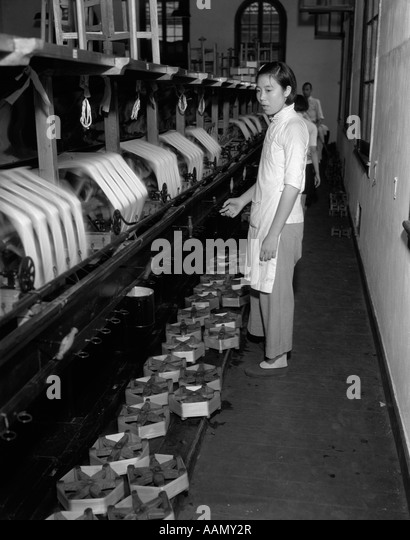 1920s 1930s chinese woman silk factory worker at winding machines stock photo  royalty free