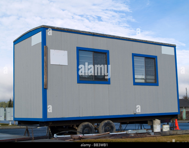 stock photo a small portable office on wheels at a construction site