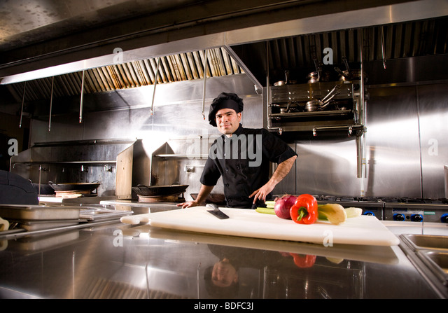 Professional Chef In Restaurant Kitchen With Cutting Board And Stock Photo Royalty Free Image