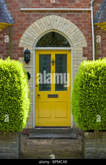 Victorian Paneled And Glazed Yellow Painted Front Door Of