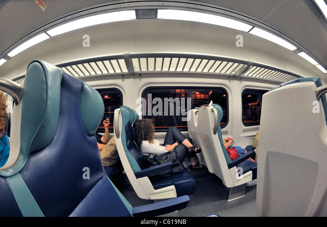 lirr train interior with passengers sitting waiting to leave penn stock photo royalty free. Black Bedroom Furniture Sets. Home Design Ideas