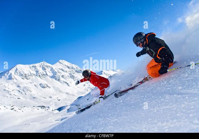 Carving skiing extreme man woman ski winter sports
