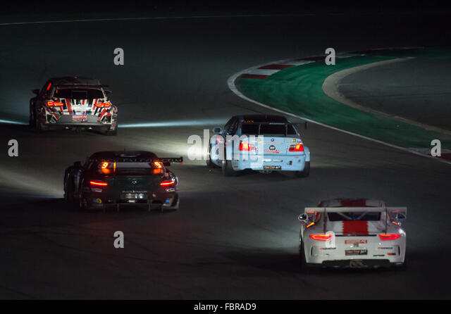 A mix of different car types on the track during the night section